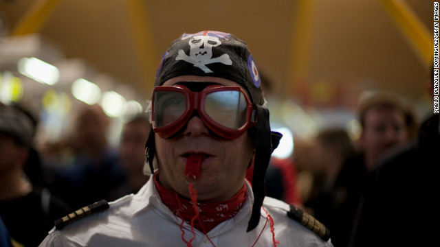 A Spanish Airline Iberia staff member blows a whistle during a protest against job cuts at Barajas Airport.