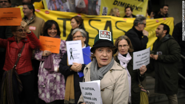 Court officials protest on February 20 in Madrid, during a strike called by judges, prosecutors and justice workers against the government's spending cuts.