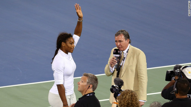 Serena Williams delivers an on court interview as she withdraws from her match on the third day of the Dubai event.