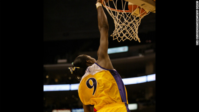 Lisa Leslie of the Los Angeles Sparks records the first slam dunk in women's professional basketball during a game against the Miami Sol on July 30, 2002, in Los Angeles.