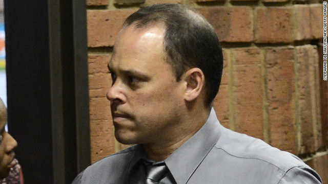 South African detective Hilton Botha, the investigating officer in the Oscar Pistorius case, himself faces seven charges of murder for shooting at a taxi with seven passengers in it.