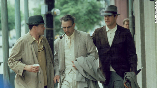 "Kevin Costner, center, plays District Attorney Jim Garrison, who investigates the assassination of President John F. Kennedy, in the 1991 Oliver Stone film ""JFK."""