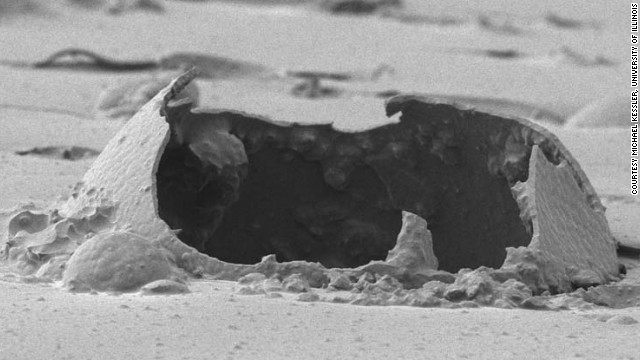 This image, taken using a scanning electron microscope, shows a ruptured microcapsule contained in a self-healing epoxy.