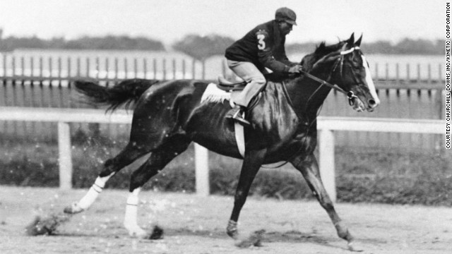 "Winkfield rides to victory in the 1902 Derby. ""He was the LeBron James of his time. Not only was he fabulously talented, he transcended the sports pages to the celebrity pages,"" author Joe Drape said."