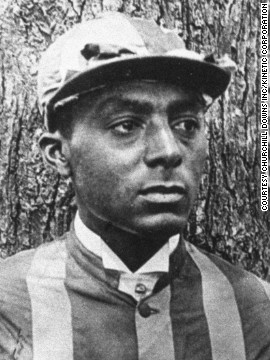 "Isaac Murphy was the first jockey to win three Kentucky Derbies -- in 1884, 1890, 1891 -- and the first millionaire black athlete. ""They came at a time when blacks were invisible,"" Drape added."