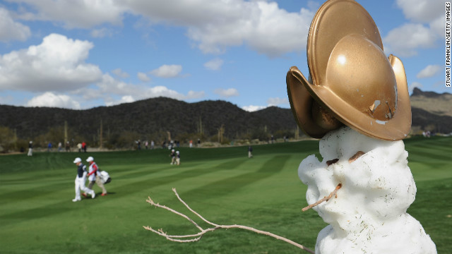 &quot;Frosty the Snowman&quot; keeps cool while the players get back to work in Arizona. Frosty is modeling a new hat too.