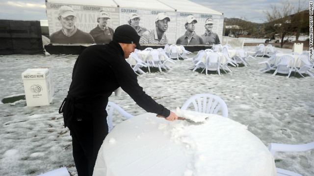 It's not just on the course where the snow caused havoc. Organizers were forced to get their scrapers out to make sure fans could sit down and enjoy a drink or two.
