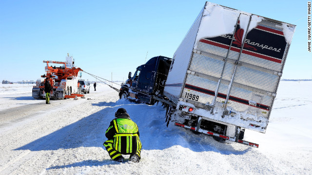 Tow truck drivers aid a semi on February 22 in Greensburg, Kansas.