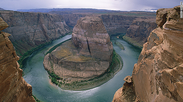 Called &quot;King Bend,&quot; by locals, the U-shaped meander of the Colorado River known to the world as Horseshoe Bend flows 1,000 feet below the overlook.