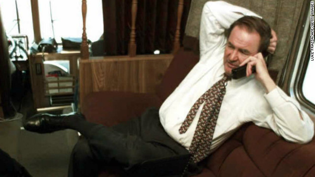 Republican presidential candidate Pat Buchanan does a radio interview via a clunky cellphone from his campaign bus in Roswell, Georgia, in March 1996.