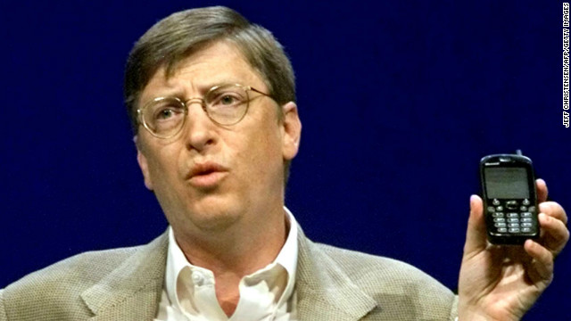 Even Microsoft chairman Bill Gates was not immune from holding ugly phones. Here he makes a point with a &quot;new generation&quot; cellphone during his annual &quot;state of the industry&quot; speech at the COMDEX convention in Las Vegas in November 2000.