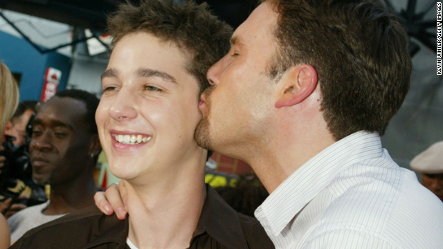 "Affleck kisses Shia LaBeouf at the premiere of ""The Battle of Shaker Heights,"" a film he and Matt Damon executive produced in 2003."