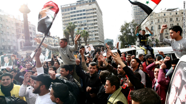 Syrian protesters chant slogans in support of al-Assad during a rally in Damascus on March 25, 2011.