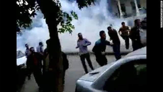 A screen grab from YouTube shows Syrian anti-government protesters run for cover from tear gas fired by security forces in Damascus on April 29, 2011, during the