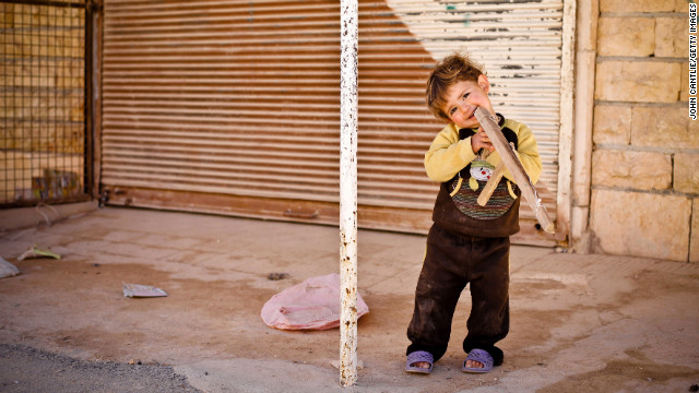 A young boy plays with a toy gun in Binnish on April 9.