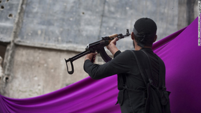 A Syrian rebel fires at an army position in the Karm al-Jabal district of Aleppo on October 22, 2012.