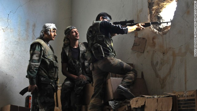 Rebels hold their position in the midst of a battle on November 3 in Aleppo.