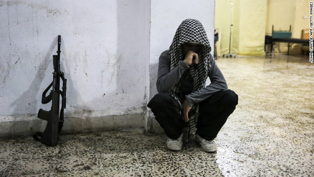 A Syrian rebel mourns the death of a comrade in Maraat al-Numan on November 20, 2012.