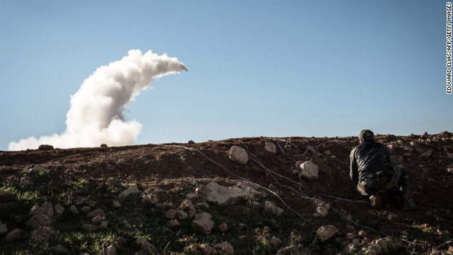 Syrian rebels launch a missile near the Abu Baker brigade in Albab on January 16.