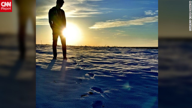 <a href='http://ireport.cnn.com/docs/DOC-932219' target='_blank'>Kyler Franklin</a> shares his photo of snow dusted footprints leading up to a reflective moment.