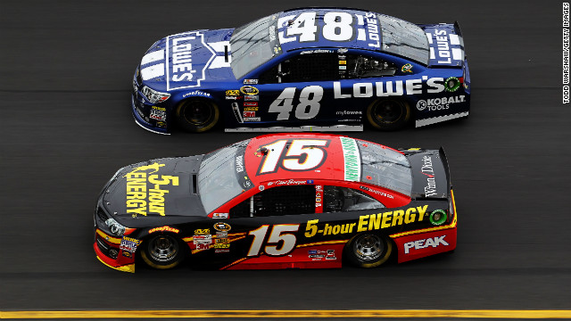 No. 48 Jimmie Johnson races neck and neck with No. 15 Clint Bowyer.
