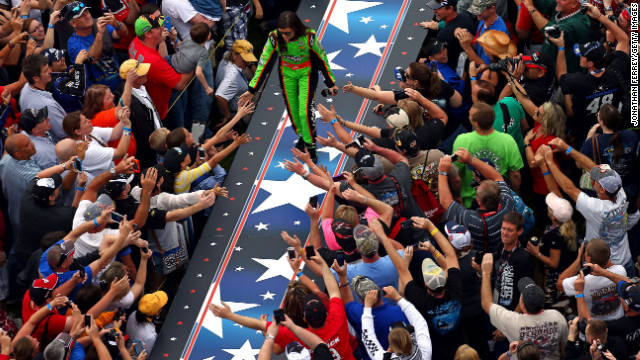 Danica Patrick greets the crowd during driver introductions before the start of the Daytona 500.