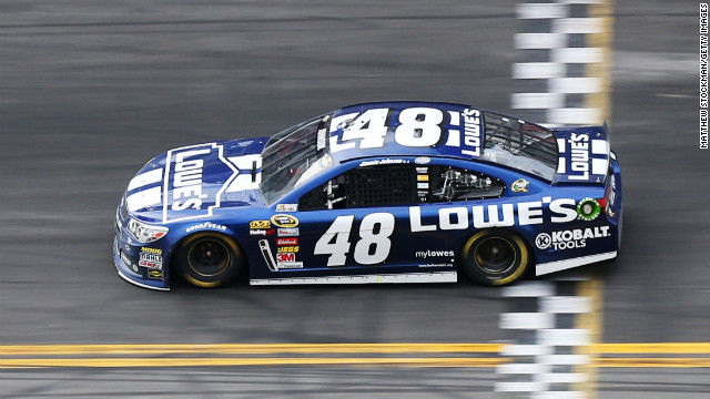 Jimmie Johnson crosses the finish line to win the Daytona 500. Dale Earnhardt Jr. finished second, and Mark Martin finished third.