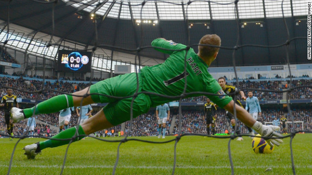 Joe Hart stretches to save Frank Lampard's second half penalty for Chelsea at the Etihad Stadium. 