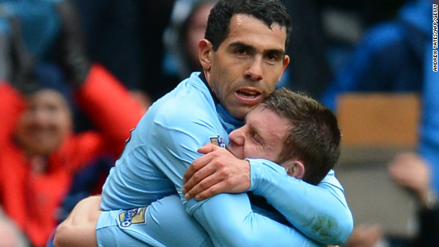 Carlos Tevez is hugged by James Milner after the Argentina star scored Manchester City's second goal against Chelsea in the 2-0 win.