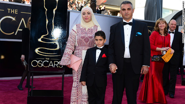 Best Documentary Feature nominee Emad Burnat, right, his wife and son