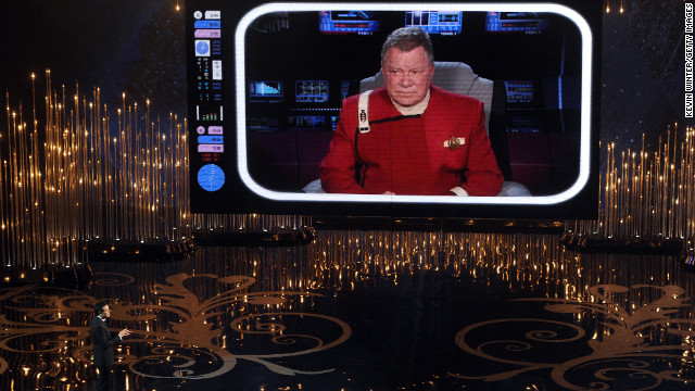 MacFarlane talks to William Shatner on the video screen during his opening. Shatner gives the host tips to make sure tomorrow's headlines don't read &quot;worst Oscar host ever.&quot;