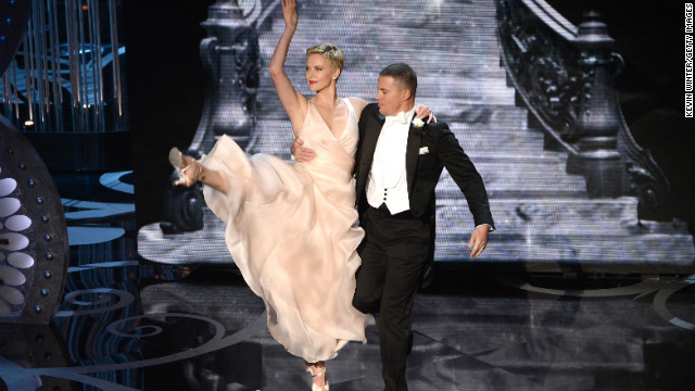 Theron dances with fellow actor Channing Tatum during the the 2013 Academy Awards ceremony held in Hollywood.