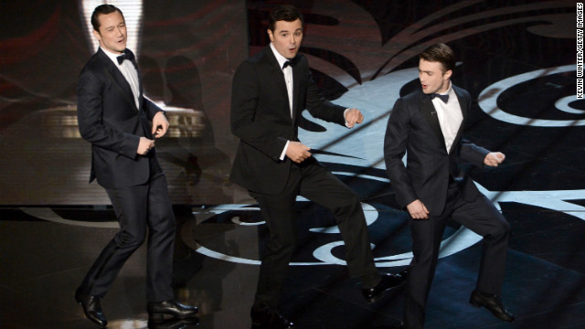 Joseph Gordon-Levitt, left, and Daniel Radcliffe, right, join MacFarlane onstage for a rendition of &quot;High Hopes.&quot;