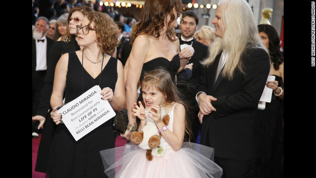 "Chilean nominee for Best Cinematography Claudio Miranda for the film ""Life of Pi,"" with daughter Sofia and wife"