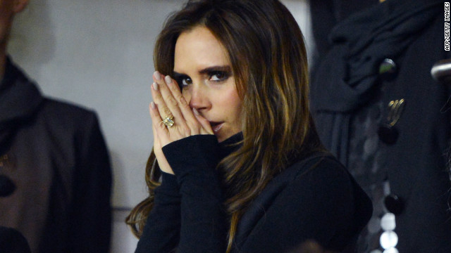 Beckham's wife Victoria weathered the bitterly cold conditions in the French capital as she watched from the stands.
