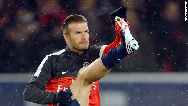 Beckham warms up his 37-year-old limbs ahead of the match against Marseille at the Parc des Princes.