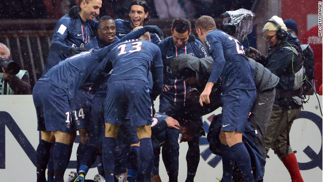 Beckham's teammates celebrate their opening goal in the 2-0 win over Marseille which left them three points clear at the top.