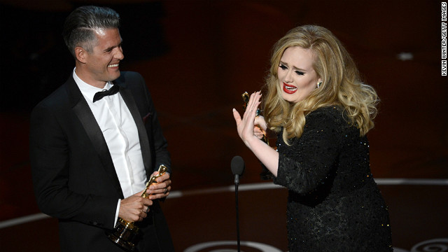 Songwriter Paul Epworth and singer Adele accept the Oscar for best original song for &quot;Skyfall.&quot; An emotional Adele thanked &quot;my man&quot; before turning the microphone over to Epworth.