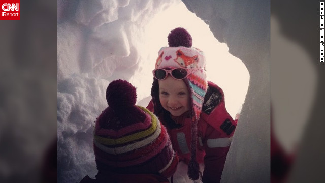 <a href='http://ireport.cnn.com/docs/DOC-932875' target='_blank'>Gørill Husby Moore</a>'s daughter plays peekaboo with her younger cousin in a snow cave they built.