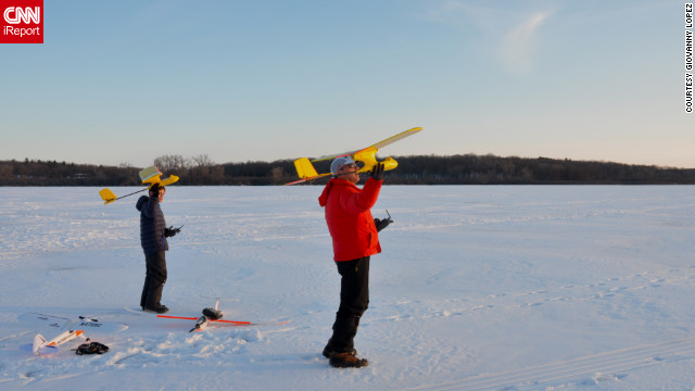iReporter <a href='http://ireport.cnn.com/docs/DOC-932508' target='_blank'>Giovanny López</a> captured this father and son moment as they flew model airplanes over Lake Wingra in Madison, Wisconsin.