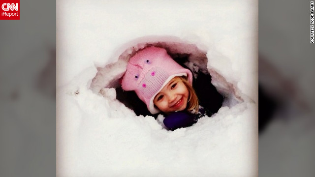 "<a href='http://ireport.cnn.com/docs/DOC-932876' target='_blank'>Todd Laabs</a> snapped this photo of his adorable 4-year-old daugther in his backyard in Minneapolis over the weekend. ""We have accumulated quite a big snow pile in our yard and it's perfect for digging snow forts,"" he said. ""We lived in California for several years, so the kids are loving the snow this year.""<!-- --> </br>"