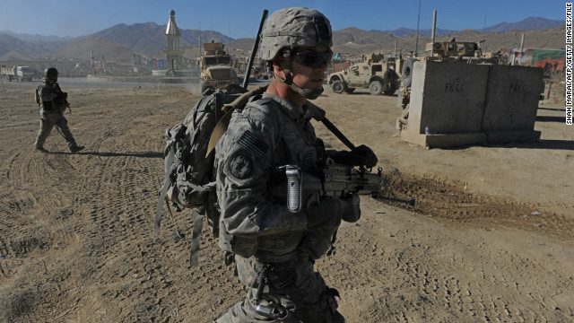 (File photo) US soldiers walk during a patrol in Wardak province on December 2, 2010. 