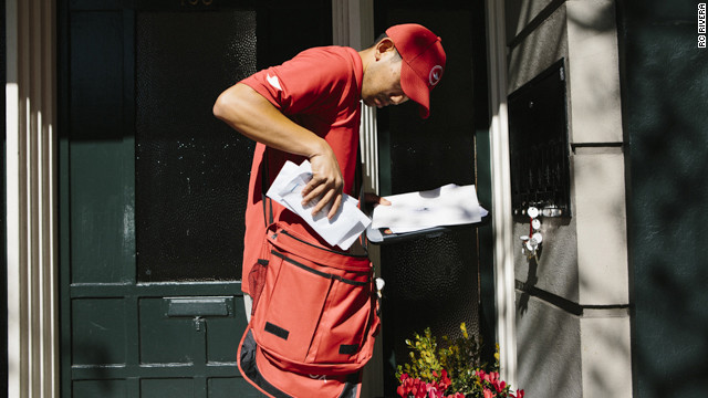 "Outbox ""unpostman"" Francis uses one of his many keys to pick up mail from a customer. The mail will be taken to a warehouse to be digitized, then sent electronically to the client."