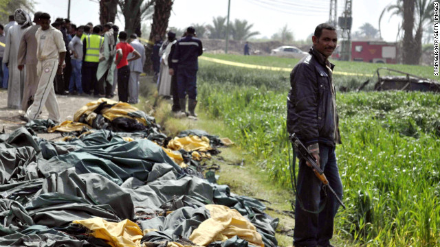 Egyptians inspect the site where a hot air balloon exploded over the city of Luxor on Tuesday, February 26. Eighteen tourists were killed when the balloon dropped almost 1,000 feet (about 300 meters), authorities said. Three people were injured.