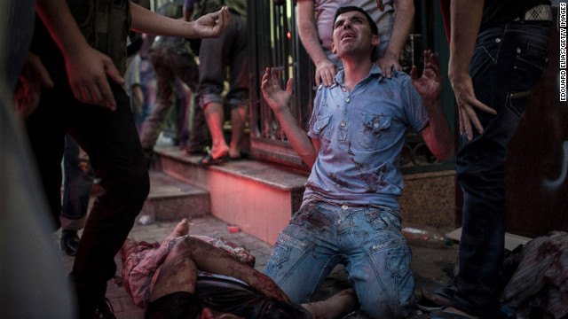 A man mourns in front of a field hospital on August 21 in Aleppo.