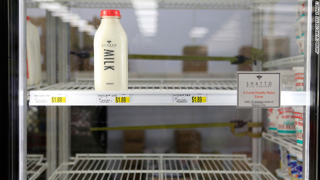Milk shelves are nearly empty at a Kansas City, Missouri, grocery store on February 26, after a snowstorm batters the area again.