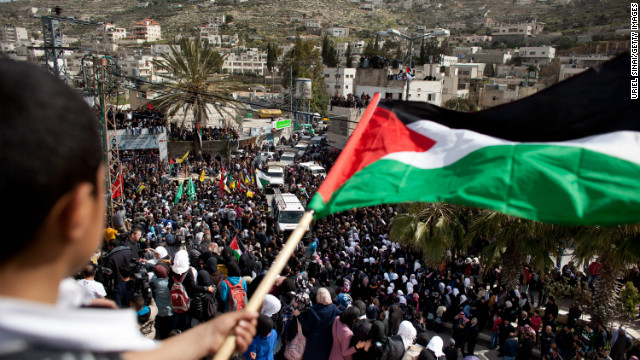 Palestinians take part in the funeral of Arafat Jaradat on February 25, 2013 in the village of Saair in the West Bank.