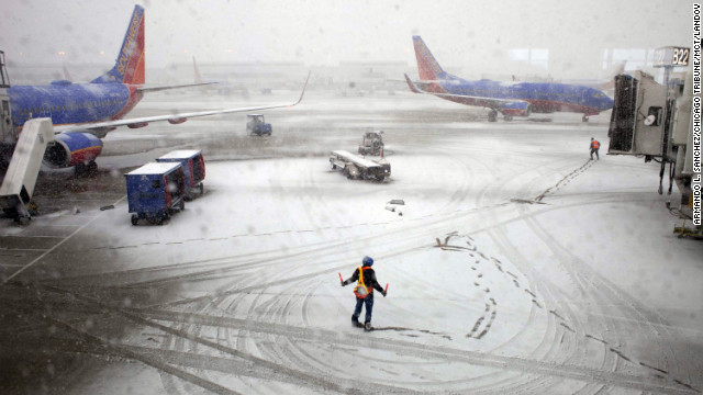 Southwest Airlines employees guide a plane into the gate at Midway International Airport in Chicago on Tuesday, February 26. Back-to-back storms have hit the Great Plains, which is still digging out from last week's weather. Are you experiencing the storm? If it's safe, share your photos.
