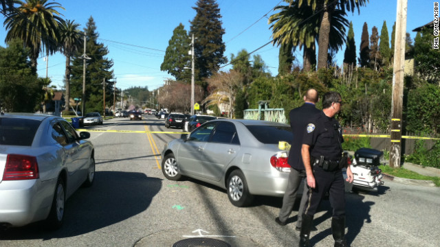 Police arrive on the scene in the aftermath of the shooting Tuesday of two police officers in Santa Cruz, California.