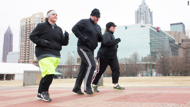 Stacy Mantooth, center, runs with Fit Nation teammates Annette Miller, left, and Tabitha McMahon.